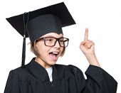 Portrait Of A Graduate Teen Girl Student In Black Graduation Gown With Hat Has Idea, Pointing Finger poster