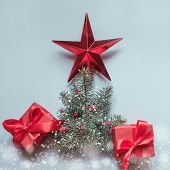 Imitation Christmas Tree With Red Giftboxes. Flat Lay. Top View. Xmas Decoration Card. poster