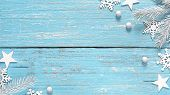 White Christmas Fir Tree Branches Decorative Snowflakes And Stars On Shabby Light Blue Wooden Rustic poster