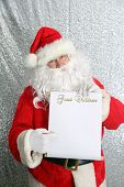 Santa Claus. Santa Claus with his Naughty or Nice List of Good or Bad Children. Santa Holds his list poster