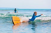 Happy Boy - Young Surfer Learning Ride And Fall From Surfboard With Fun. Active Family Lifestyle. Ki poster