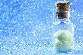 Pills In Glass Bottle Spread On Blue Glitter, Sparkles, Sparkling Background Copy Space. Global Heal poster