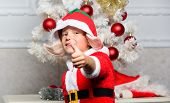 Christmas Party With Elf Costume. Christmas Tree Ideas For Kids. Boy Kid Dressed As Cute Elf Magical poster
