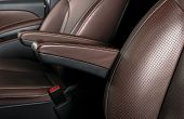 Modern Luxury Car Brown Leather Interior. Part Of Leather Car Seat Details With White Stitching. Int poster