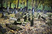 stock photo of polonia  - Old graves at historic Jewish cemetery Okopowa Street in Warsaw Poland - JPG