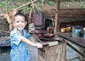 stock photo of wooden box from coffee mill  - little boy with Vintage coffee mill grinder - JPG