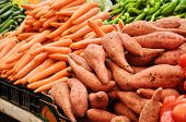 stock photo of batata  - Close Up Of Sweet Potato And Carrot On Market Stand - JPG