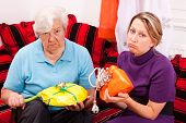 stock photo of loveless  - old and young woman are getting uninspired gifts - JPG