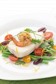 foto of halibut  - Poached halibut with spicy shrimp green beans cherry tomatoes black olives and citrus sauce. ** Note: Shallow depth of field - JPG
