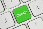 stock photo of soliciting  - Green donate button on the keyboard close - JPG