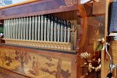 stock photo of pipe organ  - Beautiful pipe organ with elaborate inlay woodwork - JPG
