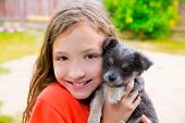 stock photo of hairy  - Beautiful kid girl portrait with puppy chihuahua gray dog - JPG