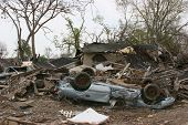 stock photo of katrina  - car and house damaged by hurricane katrina - JPG