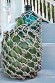 stock photo of macrame  - Bottles wrapped in macrame on deck stairway - JPG