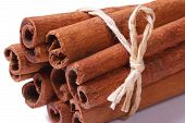 foto of bundle  - Bundle of cinnamon sticks closeup isolated on white background Macro - JPG