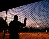 image of softball  - a silhouette of a baseball - JPG