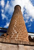 image of sugar industry  - Ancient brick pipe in the old sugar cane factory - JPG