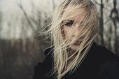 image of sorrow  - portrait of a beautiful girl on windy day - JPG