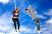 pic of tarzan  - People hanging on a rope with a sky as background - JPG