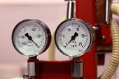 foto of air pressure gauge  - Arrangement consisting of industrial instruments for measuring the gas pressure and liquid - JPG