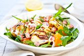 stock photo of rocket salad  - Grilled Halloumi with Pomegranate Orange and Rocket salad