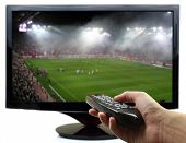 picture of football pitch  - Tv screen with football match and hand with remote control - JPG