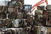 picture of ferrous metal  - Metal bales in a junkyard with grabber - JPG