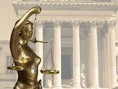 stock photo of metal sculpture  - Justice statue is on against the courthouse - JPG
