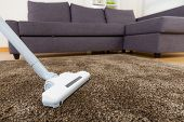 picture of suction  - Carpet with vacuum cleaner in living room - JPG