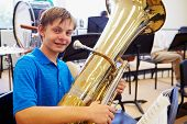 foto of orchestra  - Male Pupil Playing Tuba In High School Orchestra - JPG