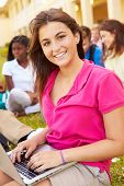 stock photo of playground school  - High School Students Studying Outdoors On Campus - JPG