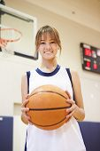 stock photo of 13 year old  - Portrait Of Female High School Basketball Player - JPG