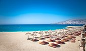 pic of albania  - Sunshade umbrellas and deckchairs on the beautiful  Mango beach in Saranda - JPG