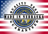foto of nebraska  - Quality test guaranteed stamp with a state flag inside Nebraska - JPG