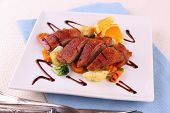 image of duck breast  - Roasted duck breast fillet vegetables with orange close up - JPG
