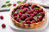 stock photo of tarts  - Delicious chocolate tart with raspberry on the white plate - JPG