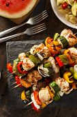 stock photo of kababs  - Homemade Chicken Shish Kabobs with Peppers and Onions - JPG