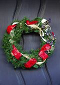 stock photo of anjou  - Christmas Wreath Decoration Red Ribbons Mission San Luis Obispo de Tolosa San Luis Obispo California - JPG