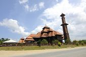 picture of malay  - TERENGGANU, MALAYSIA - APRIL, 2014: Located at Jerteh, Terengganu, Malaysia. Completed in 2012. Designed and crafted by local wood craftsman, the mosque is built according to traditional Malay architectural concept.