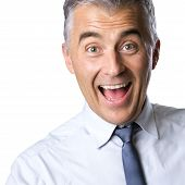 stock photo of raised-eyebrow  - Cheerful excited businessman with mouth open and raised eyebrows on white background - JPG