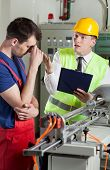 stock photo of yell  - Supervisor yelling at worker in a factory - JPG
