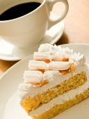 picture of cup coffee  - Cup of coffee and tasty cream cake with apricots - JPG