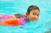 foto of indian blue  - Asian girl in swimmer class with float bands - JPG
