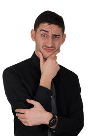picture of thinkers pose  - Young man with a funny perplexed expression - JPG