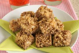 foto of crispy rice  - Caramel and chocolate rice crispie cakes popular childrens treat - JPG