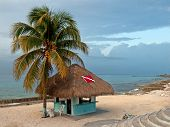 pic of beach hut  - This photo was taken just before sunset on a beach in Cozumel - JPG