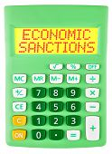 stock photo of macroeconomics  - Calculator with ECONOMIC SANCTIONS on display isolated on white background - JPG