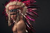 pic of headdress  - Naked indian strong man with traditional native american make up and headdress looking at the camera - JPG
