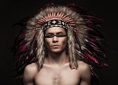 picture of headdress  - Portrait of the naked indian strong man posing with traditional native american make up  and headdress looking at the camera - JPG