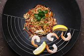 foto of chinese wok  - Chinese noodles with vegetables and seafood in wok - JPG